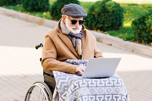 senior disabled man in wheelchair wi