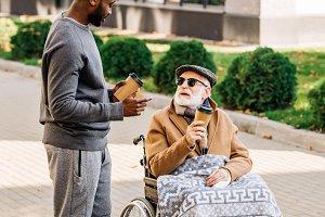 senior disabled man in wheelchair wi