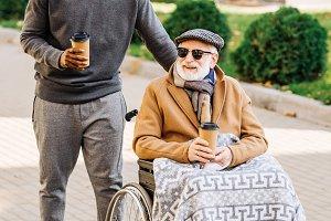 smiling senior disabled man in wheel