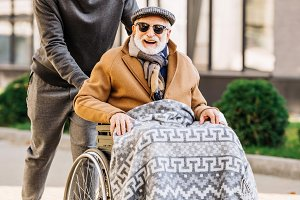 happy senior disabled man in wheelch