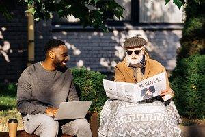 happy senior disabled man reading bu
