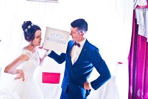 Beautiful happy wedding couple holdi