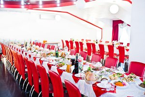 Red chairs with table for wedding gu