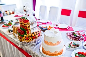 Two wedding cakes at table of newlyw