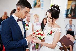 Amazing couple putting wedding rings