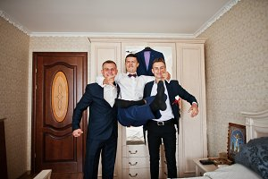 Handsome groom and groomsman in the