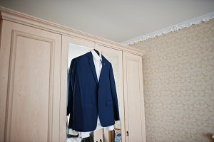 Blue wedding suit on hangers for gro