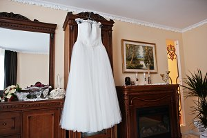 White wedding dress on hangers for b