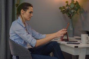 Female using iPad at home