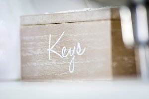 """Wooden box with the inscription """"key"""