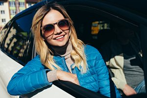smiling woman in sunglasses looking