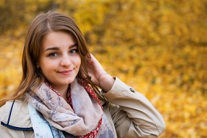 Cute happy young woman portrait in a