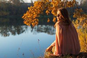 Young pretty woman enjoying sunset