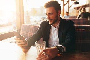 Millennial businessman sitting in a