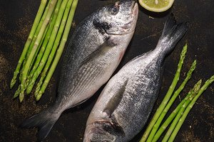 Fresh dorado fish with asparagus and
