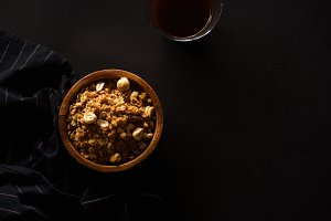 Roasted granola with nuts in wooden