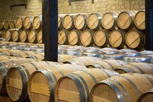 Wine wooden barrels in a storehouse