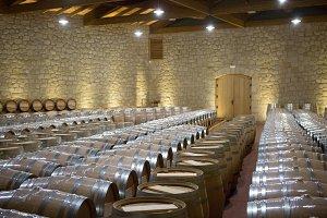 Wine wooden barrels in a warehouse