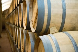 Wooden wine barrels stacked