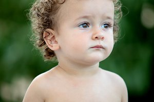Beautiful baby with curly hair in th