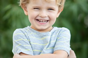 Happy child with blue t-shirt in the