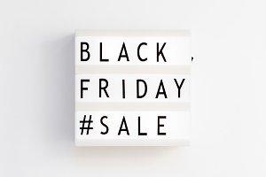 Black friday sale text on white ligh