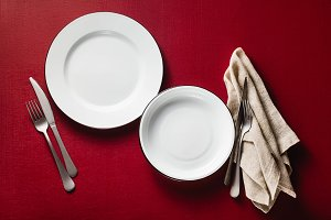 empty dining table set for two. two