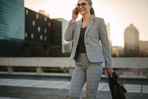 Businesswoman walking outdoors