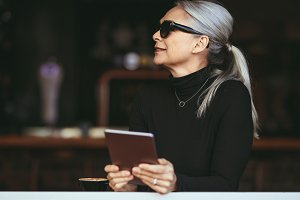 Mature woman at a coffee shop