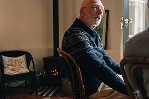 Senior man sitting on a chair