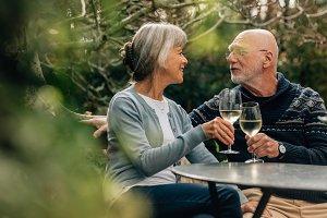 Senior couple toasting wine