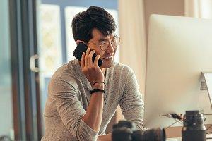 Photo editor talking on phone