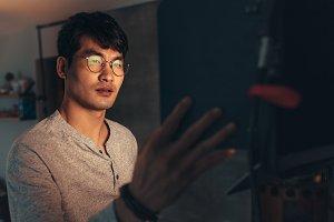 Photographer adjusts lights