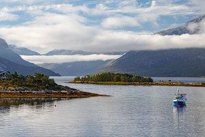 A fishing boat in a cloudy Norwegian