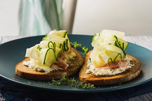 Rye bread toasts with cheese, ham