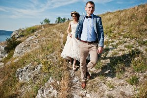 Beautiful wedding couple walking and