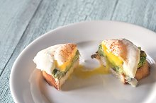 Cut sandwich with guacamole and egg