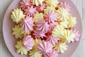 Mini meringues on pink plate