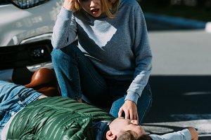 shocked young woman looking at injur