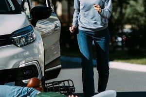 shocked woman running to injured cyc