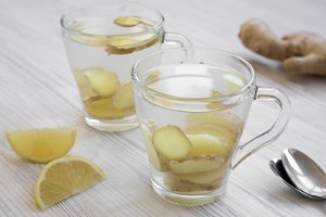 Two mugs of homemade ginger tea with