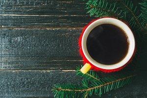 Mug of hot coffee on a dark wooden b