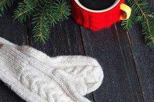Coffee mug with warm winter mittens