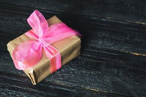 Gift Packed in paper with pink ribbo
