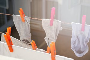 Wet socks drying hanging