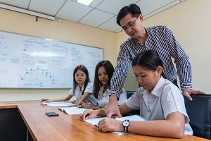 Asian teacher Giving Lesson to group