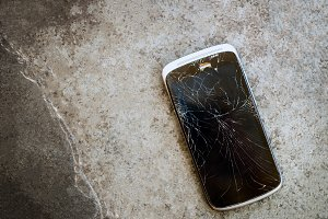 Old Black Cracked Touch Screen Phone