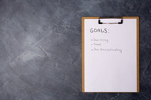 List of goals on grey table. Free