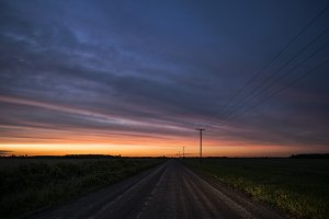 Sunset down a dirt road
