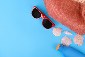 Top view of sunglasses, shells and s